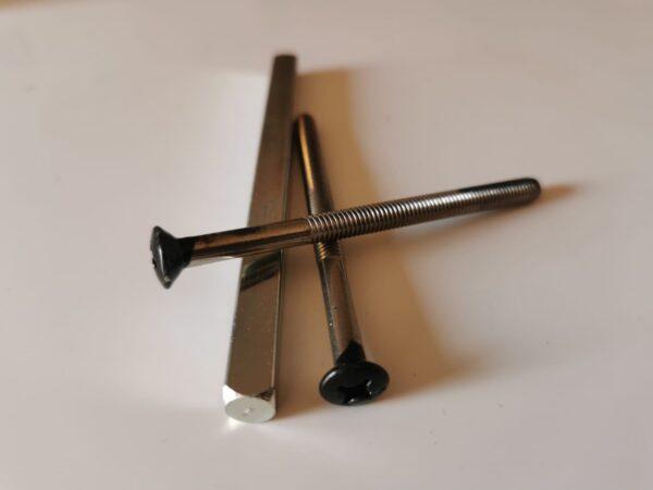 screws for door handles, black door handle screws, the bar for opening hte door, bars going through the door lock and handle to open teh door, spindle for doors